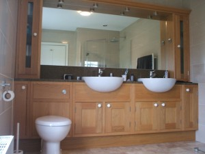 Solid Oak fitted bathroom furniture with built in double sink
